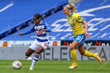 Danielle Carter (Reading 18) passes the ball during the Barclays FA Womens Super League game between Reading and Brighton & Hove Albion at The Madejski Stadium in Reading.