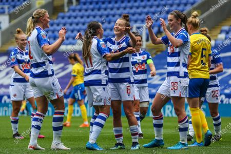 Stock Image of Angharad James (Reading 6) celebrates with team mates after Danielle Carter (Reading 18) scores the second goal of the match during the Barclays FA Womens Super League game between Reading and Brighton & Hove Albion at The Madejski Stadium in Reading.