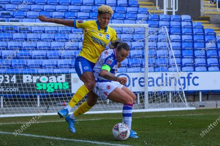 Natasha Harding (Reading 11) holds off Victoria Williams (Brighton 20) during the Barclays FA Womens Super League game between Reading and Brighton & Hove Albion at The Madejski Stadium in Reading.