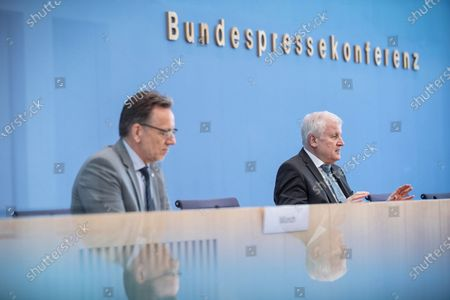 German Interior Minister Horst Seehofer (R) and Holger Muench, President of Germany's Federal Crime Bureau (Bundeskriminalamt), speak to the media to present the 2020 report of politically motivated crime in Berlin, Germany, 04 May 2021. 2020 saw the highest level of politically-motivated crime in Germany since 2001, with over 44,000 registered cases that include right-wing, left-wing, Reichsbuerger, Islamist and other radical groups and individuals.