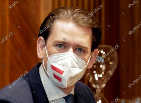 Austria's Chancellor Sebastian Kurz, wearing a protective face mask with the Austrian flag prior to a business meeting with Slovakia's Prime Minister Eduard Heger in Vienna, Austria
