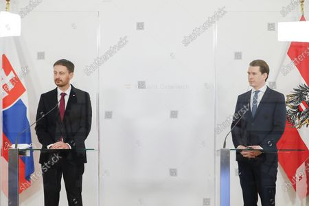 Slovakian Prime Minister Eduard Heger, on the left, and Austria's Chancellor Sebastian Kurz, speak during a news conference about the outcome of their business meeting in Vienna, Austria