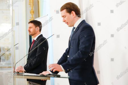 Slovakian Prime Minister Eduard Heger, on the left, and Austria's Chancellor Sebastian Kurz speak during a news conference about the outcome of their business meeting in Vienna, Austria