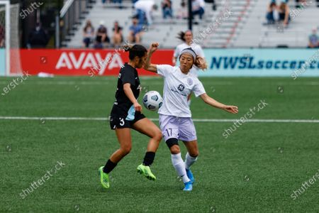 Stock Picture of Yuki Nagasato (17 Racing Louisville FC) challenges Caprice Dydasco (3 Gotham FC) for the ball during the National Womens Soccer League game between Gotham FC and Racing Louisville FC at Pittser Field in Montclair, New Jersey, United States of America.