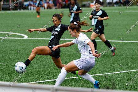 Caprice Dydasco (3 Gotham FC) attempts to block a cross from Emily Fox (11 Racing Louisville FC) during the National Womens Soccer League game between Gotham FC and Racing Louisville FC at Pittser Field in Montclair, New Jersey, United States of America.