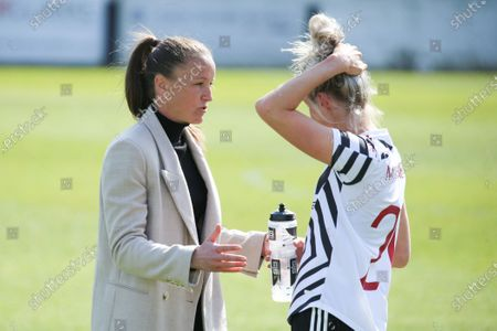 Casey Stoney (Manchester United manager) and Millie Turner (21 Manchester United) during the WSL game between Bristol and Manchester United at Twerton Park in Bath, England