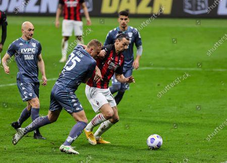Zlatan Ibrahimovic of AC Milan and Kamil Glik of Benevento Calcio in action