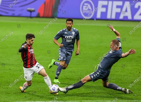 Stock Photo of Brahim Diaz of AC Milan fights for the ball against Kamil Glik of Benevento Calcio