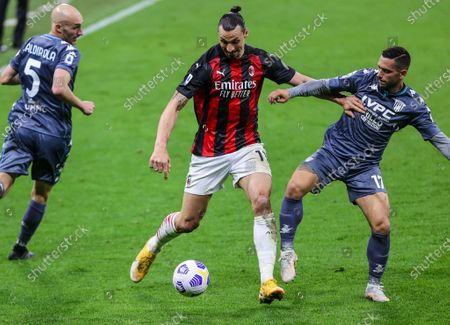 Stock Picture of Zlatan Ibrahimovic of AC Milan fights for the ball against Gianluca Caprari of Benevento Calcio