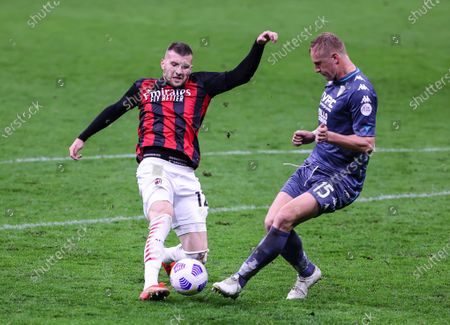 Stock Image of Ante Rebic of AC Milan fights for the ball against Kamil Glik of Benevento Calcio