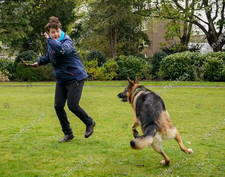 Ruth Davidson - Leader of the Conservative Party in the Scottish Parliament throws a stick for a dog called Kai while campaigning with Douglas Ross - Leader of the Scottish Conservative Party in a park in Musselburgh, Edinburgh today.