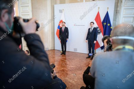 Austrian Chancellor Sebastian Kurz (R) and Slovak Prime Minister Eduard Heger (L) pose for photographs ahead of a meeting at the Austrian Chancellery, in Vienna, Austria, 04 May 2021. Eduard Heger is on a working visit in Vienna.