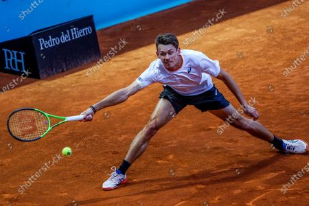 Alex de Minaur of Australia in action during his match against Lloyd Harris of South Africa at the Mutua Madrid Open tennis tournament in Madrid, Spain, 04 May 2021.