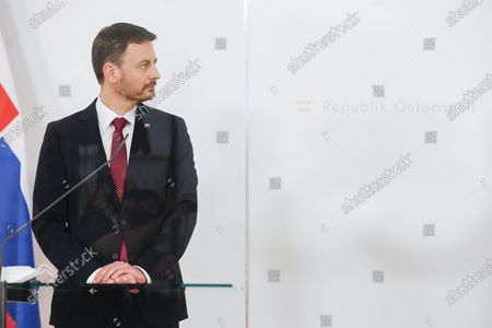 Slovakian Prime Minister Eduard Heger listens to Austrian Chancellor Sebastian Kurz who speaks during a news conference about the outcome of their business meeting in Vienna, Austria