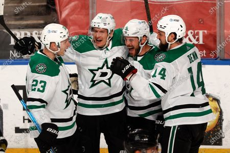 Teammates congratulate Dallas Stars center Tyler Seguin (91) after he scored a game-tying goal against the Florida Panthers during the third period of an NHL hockey game, in Sunrise, Fla