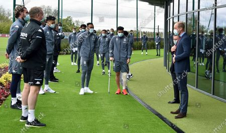 Britain's Prince William, the Duke of Cambridge, right, meets Aston Villa players during a visit to Aston Villa High Performance Centre at Bodymoor Heath Training Centre in Bodymoor Heath, England