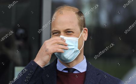 Britain's Prince William, the Duke of Cambridge reacts as he meets Aston Villa players during a visit to Aston Villa High Performance Centre at Bodymoor Heath Training Centre in Bodymoor Heath, England