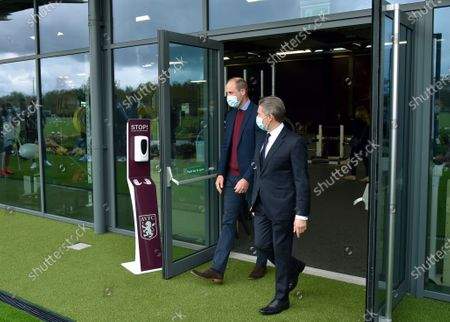 Britain's Prince William, the Duke of Cambridge, is welcomed by Aston Villa's CEO Christian Purslow, right, during a visit to Aston Villa High Performance Centre at Bodymoor Heath Training Centre in Bodymoor Heath, England