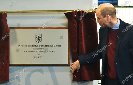 Britain's Prince William, the Duke of Cambridge, unveils a plaque, during a visit to Aston Villa High Performance Centre at Bodymoor Heath Training Centre in Bodymoor Heath, England