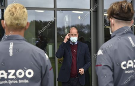 Britain's Prince William, the Duke of Cambridge, centre, meets Aston Villa players during a visit to Aston Villa High Performance Centre at Bodymoor Heath Training Centre in Bodymoor Heath, England