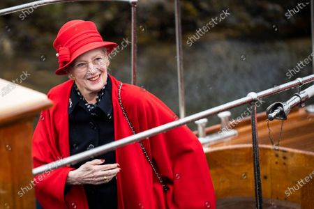 Stock Picture of Queen Margrethe II. of Denmark smiles as she officially boards the Royal Yacht 'Dannebrog' in the Port of Copenhagen, Denmark, 04 May 2021. This year's royal trip by ship will bring the Danish Queen to Greenland, Faroe Islands and other destinations.