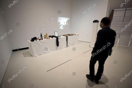 A visitor looks at a work by Serbian artist Marina Abramovic which is displayed at an exhibition titled 'Bigger than Myself, Heroic Voices from ex Yugoslavia' at the MAXXI, the National Museum of 21st Century Arts, in Rome, Italy, 04 May 2021. The art exhibition runs from 05 May to 12 September 2021.