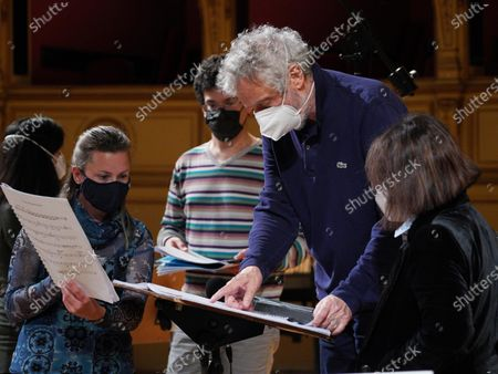 Italian composer and conductor Nicola Piovani (2-R) reads the score during the rehearsals for his first opera 'Amorosa Presenza' at the Verdi theater in Trieste, Italy, 04 May 2021.