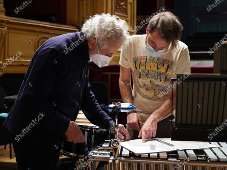 Stock Image of Italian composer and conductor Nicola Piovani (L) and a musician read the score during the rehearsals for his first opera 'Amorosa Presenza' at the Verdi theater in Trieste, Italy, 04 May 2021.