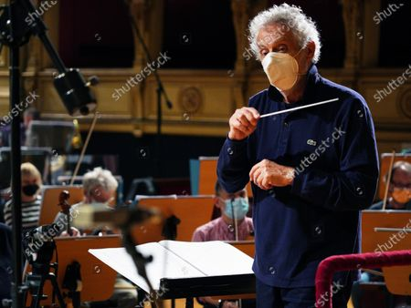 Italian composer and conductor Nicola Piovani directs the orchestra during the rehearsals for his first opera 'Amorosa Presenza' at the Verdi theater in Trieste, Italy, 04 May 2021.