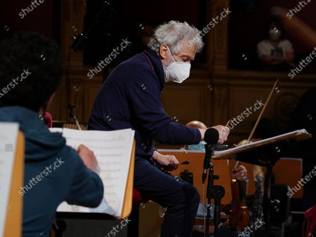 Stock Photo of Italian composer and conductor Nicola Piovani directs the orchestra during the rehearsals for his first opera 'Amorosa Presenza' at the Verdi theater in Trieste, Italy, 04 May 2021.