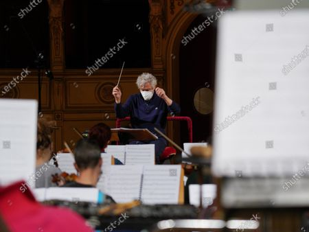 Stock Picture of Italian composer and conductor Nicola Piovani directs the orchestra during the rehearsals for his first opera 'Amorosa Presenza' at the Verdi theater in Trieste, Italy, 04 May 2021.