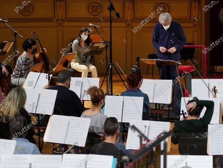 Italian composer and conductor Nicola Piovani (R, background) reads the score during the rehearsals for his first opera 'Amorosa Presenza' at the Verdi theater in Trieste, Italy, 04 May 2021.