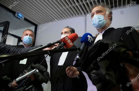 Lawyers for French member of Parliament and president of the Rassemblement National far-right party Marine Le Pen, Rodolphe Bosselut (R) and Jean-Marc Descoubes (L) speak to media after the verdict  at the Tribunal De Grande Instance, in Nanterre, a Paris suburb, France, 04  May 2021. Marine Le Pen and Gilbert Collard, a party colleague, were acquitted of charges of breaking hate speech laws by tweeting pictures of Islamic State (ISIS) atrocities in 2015.