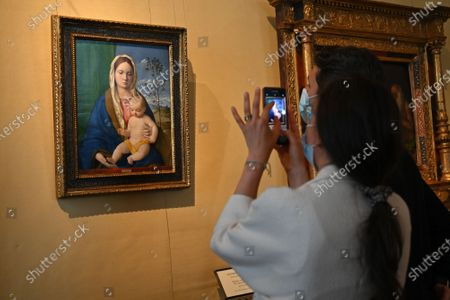 Tourist admires the painting by Giovanni Bellini ' Madonna con il bambino' (Virgin with child) in the Galleria Borghese reopened to the public as Lazio region is back to the COVID-19 yellow zone