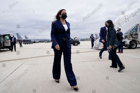 Vice President Kamala Harris walks to talk to reporters before boarding Air Force Two as she departs Milwaukee Mitchell International Airport in Milwaukee, . Harris was in Milwaukee for a visit to promote President Joe Biden's $2 trillion jobs and infrastructure plan
