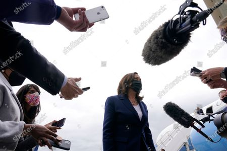 Vice President Kamala Harris talks to reporters before boarding Air Force Two as she departs Milwaukee Mitchell International Airport in Milwaukee, . Harris was in Milwaukee for a visit to promote President Joe Biden's $2 trillion jobs and infrastructure plan