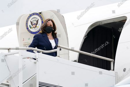 Stock Photo of Vice President Kamala Harris boards Air Force Two as she departs Milwaukee Mitchell International Airport in Milwaukee, . Harris was in Milwaukee for a visit to promote President Joe Biden's $2 trillion jobs and infrastructure plan