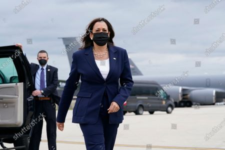 Stock Picture of Vice President Kamala Harris walks to talk to reporters before boarding Air Force Two as she departs Milwaukee Mitchell International Airport in Milwaukee, . Harris was in Milwaukee for a visit to promote President Joe Biden's $2 trillion jobs and infrastructure plan