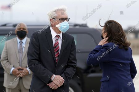 Stock Image of Vice President Kamal Harris talks with Wisconsin Gov. Tom Evers as she arrives at Milwaukee Mitchell International Airport in Milwaukee, for a visit to promote President Joe Biden's $2 trillion jobs and infrastructure plan