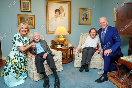 Released by The White House, former President Jimmy Carter and former first lady Rosalynn Carter pose for a photo with President Joe Biden and first lady Jill Biden at the home of the Carter's in Plains Ga