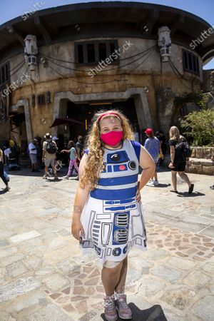 Ashley Arewy,11, from Irvine, had a dress representing her favorite Star Wars character, the droid R2-D2, while enjoying Galaxy's Edge at Disneyland Resort in Anaheim, CA, as visitors return to the park with covid-safety restrictions in place, including the park only being at 25% capacity,Monday, May 3, 2021. (Jay L. Clendenin / Los Angeles Times)