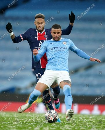 PSG's Neymar, left, challenges Manchester City's Kyle Walker during the Champions League semifinal second leg soccer match between Manchester City and Paris Saint Germain at the Etihad stadium, in Manchester