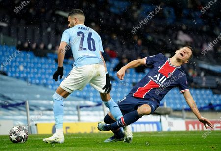 Manchester City's Riyad Mahrez, left, challenges PSG's Ander Herrera during the Champions League semifinal second leg soccer match between Manchester City and Paris Saint Germain at the Etihad stadium, in Manchester