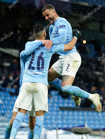 Manchester City's Riyad Mahrez, left, celebrates with Manchester City's Kyle Walker after scoring his sides second goal during the Champions League semifinal second leg soccer match between Manchester City and Paris Saint Germain at the Etihad stadium, in Manchester