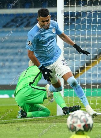 Manchester City's Riyad Mahrez celebrates after scoring his sides second goal during the Champions League semifinal second leg soccer match between Manchester City and Paris Saint Germain at the Etihad stadium, in Manchester