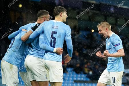 Manchester City's Riyad Mahrez celebrates with teammates after scoring his sides second goal during the Champions League semifinal second leg soccer match between Manchester City and Paris Saint Germain at the Etihad stadium, in Manchester