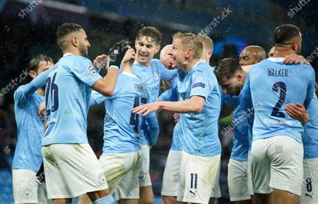 Manchester City's Riyad Mahrez, left, celebrates with teammates after scoring his sides second goal during the Champions League semifinal second leg soccer match between Manchester City and Paris Saint Germain at the Etihad stadium, in Manchester