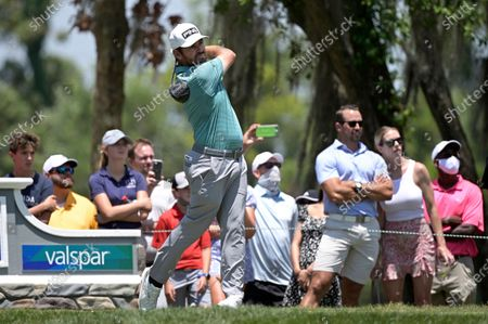 Louis Oosthuizen, of South Africa, watches his tee shot on the fifth hole during the final round of the Valspar Championship golf tournament, in Palm Harbor, Fla
