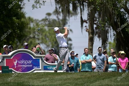Stock Image of Brandt Snedeker watches his tee shot on the fifth hole during the final round of the Valspar Championship golf tournament, in Palm Harbor, Fla
