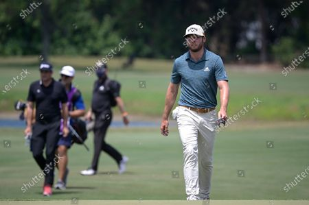 Sam Burns, right, and Keegan Bradley walk to the 16th green during the final round of the Valspar Championship golf tournament, in Palm Harbor, Fla